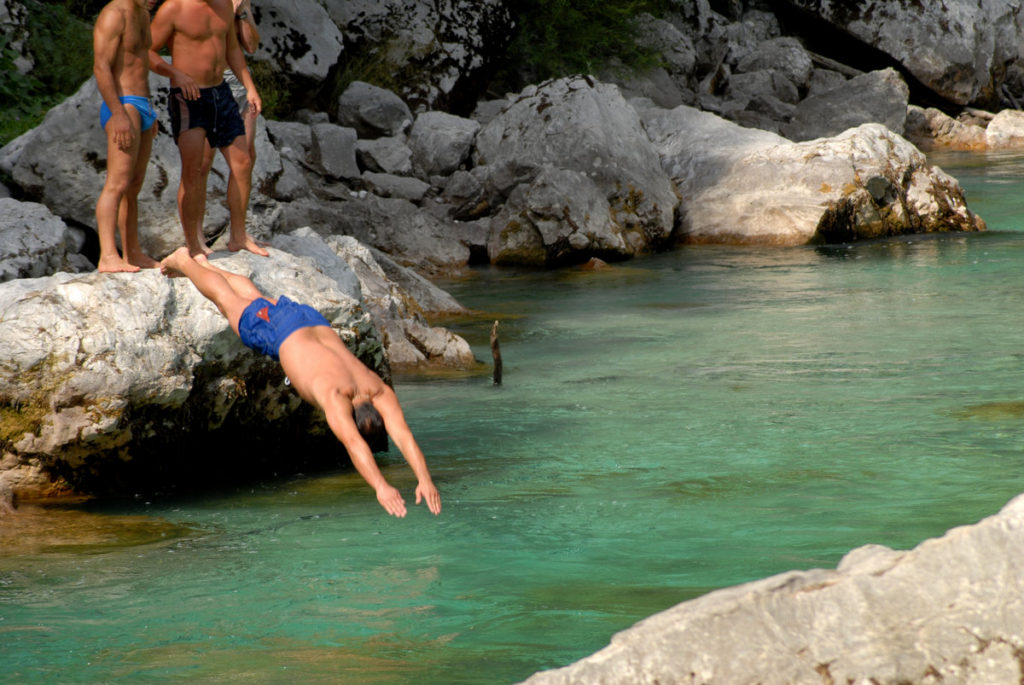Jumping into the cold Soča river. Source: Shutterstock